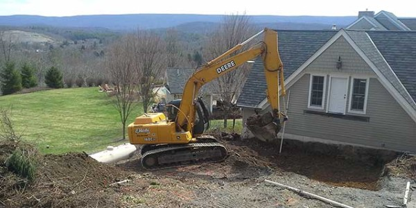 A Pictute of Bob Marki excavating for an addition in Monroe County