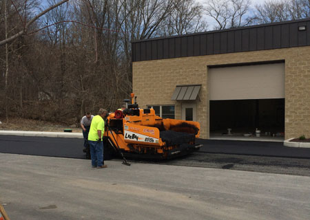 Bob Marki and crew paving the parking lot at Stoud Industrial Park