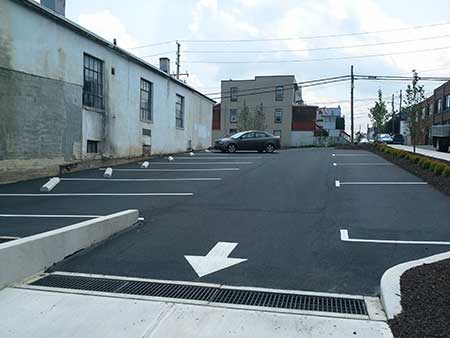 Picture of the smaller second parking lot installed along with sidewalks and curbing