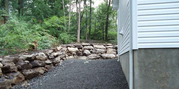 A picture of a stone retaining wall